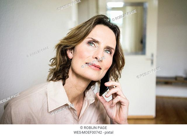 Portrait of smiling mature woman on cell phone