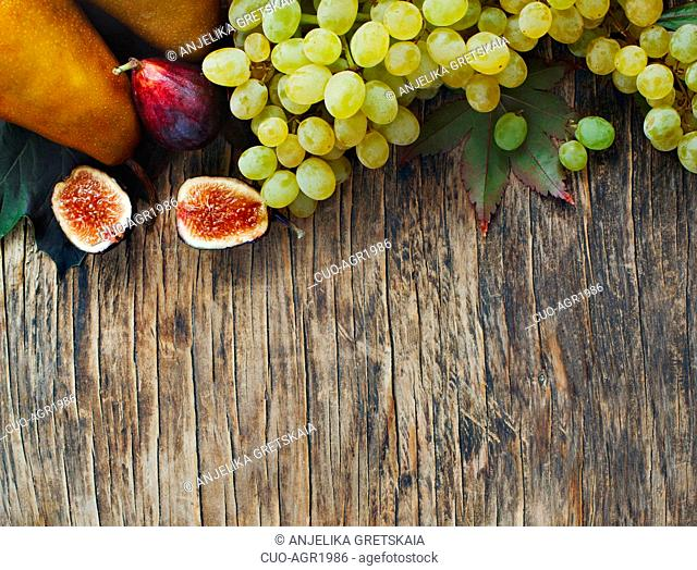 Autumn vegetables and fruits on wooden background. Autumn harvest