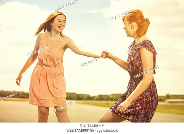 Two young women having fun together