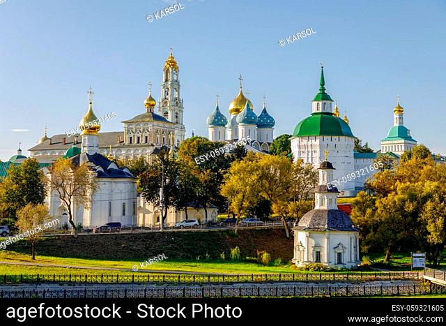 Sergiev Posad, Russia - September 14, 2018: People walking near Dormition Assumption Cathedral 1559 - 1585 in the Trinity Lavra of St. Sergius