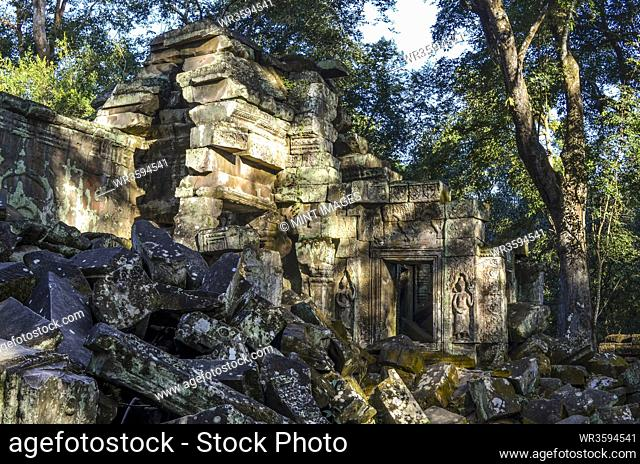 Ankor Wat, a 12th century historic Khmer temple and UNESCO world heritage site. Arches and carved stone blocks in ruins of temple pavilions