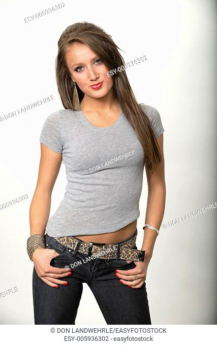 Attractive young girl in front of a white seamless
