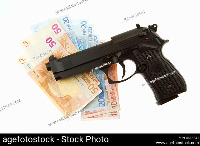 Semi-automatic gun and money isolated on white background