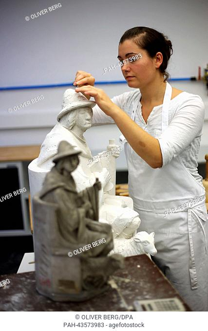 A sculpturer builds a replica of a damaged figure from the facade of the Cologne Cathedral in the restorators workshop in Cologne, Germnany, 24 October 2013