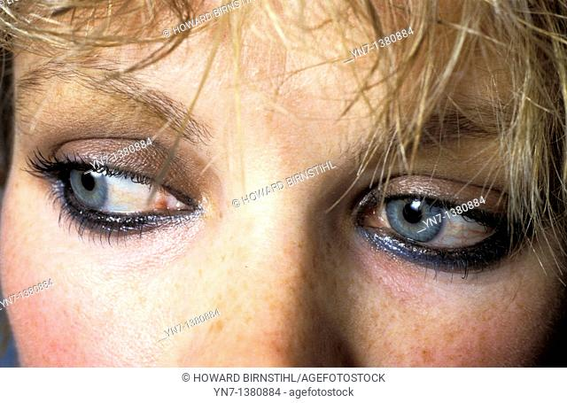 close up of a woman's eyes looking anxiously around