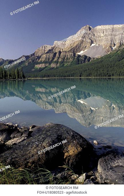 Canada, Banff National Park, Alberta, Canadian Rockies, Reflection of the surrounding mountains in the calm waters of Hector Lake in Banff National Park in...