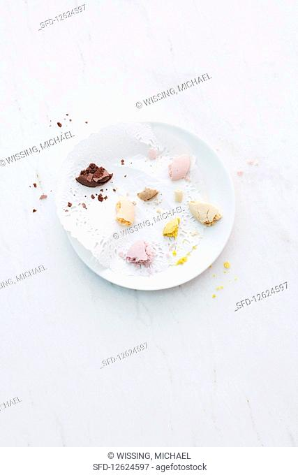 The remains of macaroons on a plate