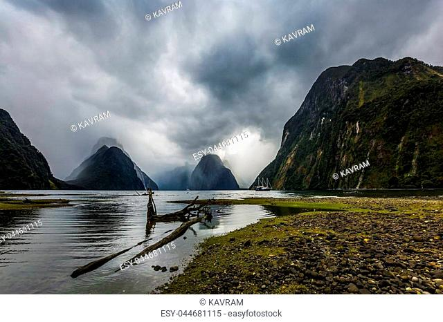 The picturesque country is New Zealand. South Island of New Zealand. Fjord Milford Sound on a stormy cloudy day. Concept of active and ecological tourism