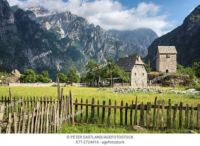 Pasture at Theth with the Kulla, lock-in tower and the Albanian Alps in the background, Northern Albania