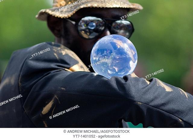 Street entertainer uses a crystal ball as part of his robotic dance  London, England