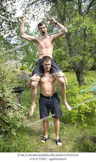 Brothers piggyback ride, Swedish archipelago