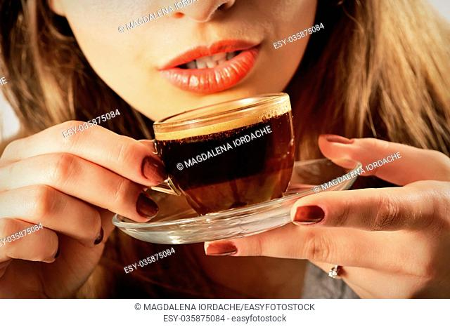 Beautiful Girl Drinking Coffee. Cup of Hot Beverage