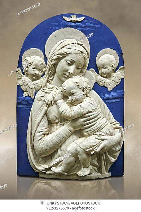 Enamelled terracotta relief panel of the Virgin and Child with two cherubs a copy of the â. œMadonna de lâ. . Impuunetaâ