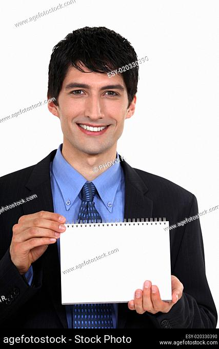 Man showing blank page on a notebook