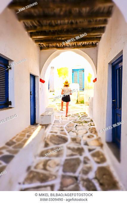 Woman on a street. Lefkes village. Paros island. Cyclades islands. Greece