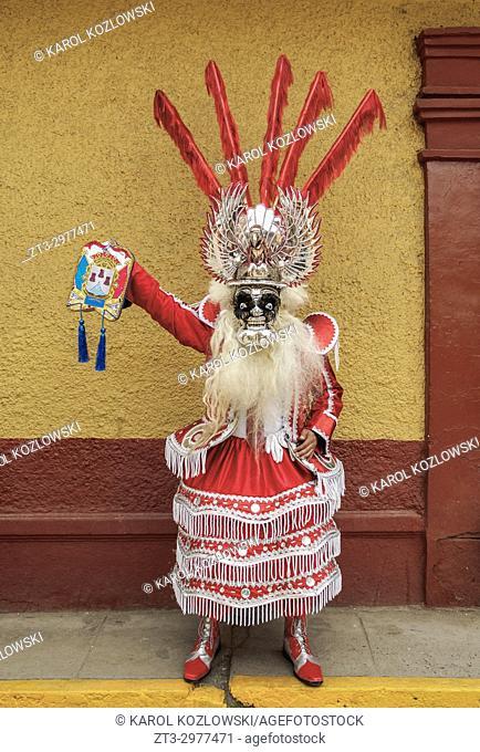 Man in traditional clothing, Fiesta de la Virgen de la Candelaria, Puno, Peru