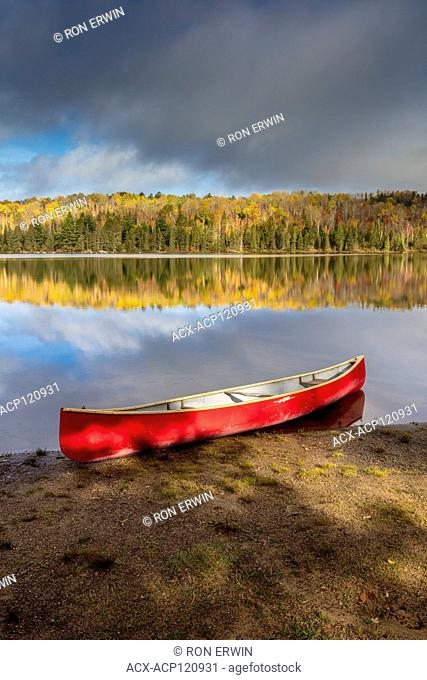 Red canoe on Canisbay Lake in Algonquin Provincial Park, Ontario, Canada