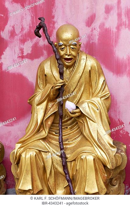 Arhat, Buddhist Sage, as an old man with a stick, gilded figure, Temple of 10,000 Buddhas, Sha Tin, New Territories, Hong Kong, China