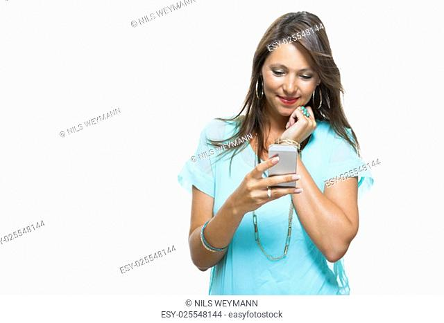 young attractive brunette woman with mobile phone isolated against a white background with copy space
