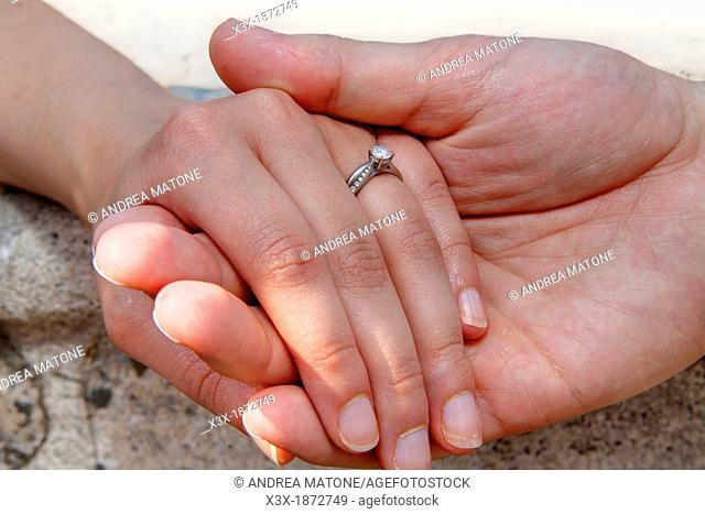 Wedding couple holding hands