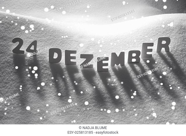 White Letters Building German Text 24 Dezember Means 24th December On White Snow. Snowy Landscape Or Scenery With Snowflakes