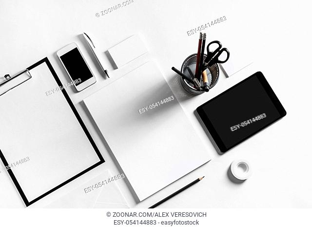 Blank stationery set on white paper background. Template for branding identity. For graphic designers presentations and portfolios. Top view