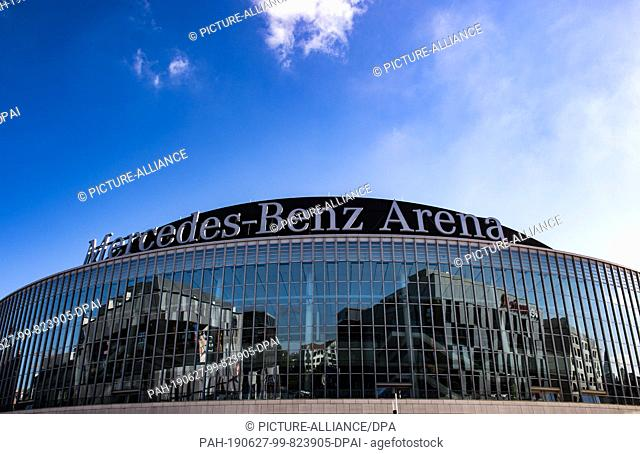 27 June 2019, Berlin: The glass facade of the Mercedes-Benz Arena reflects the buildings on the new Mercedes Platz. There is an entertainment district with a...