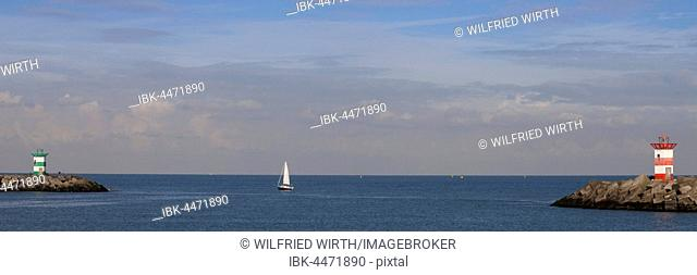 Small lighthouses at harbor entrance, Scheveningen, The Hague, Holland, The Netherlands