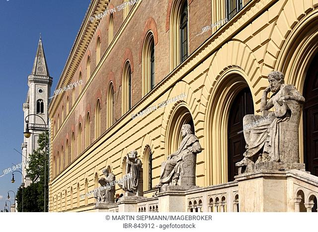 Group of Greek figures in front of the Bavarian State Library in Ludwigstrasse Street, St. Ludwig University Church can be seen in the distance, Munich