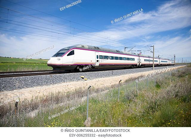 railway with high speed train at a landscape in Spain