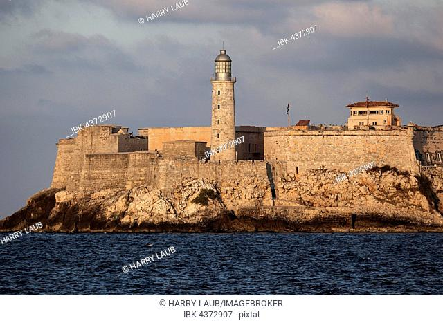 View on lighthouse and Morro Castle, sunset light, Havana, Cuba