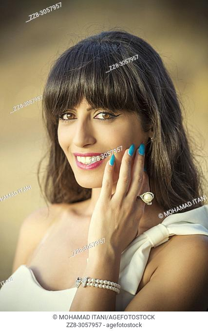 Beautiful woman hand touching face smiling outdoors