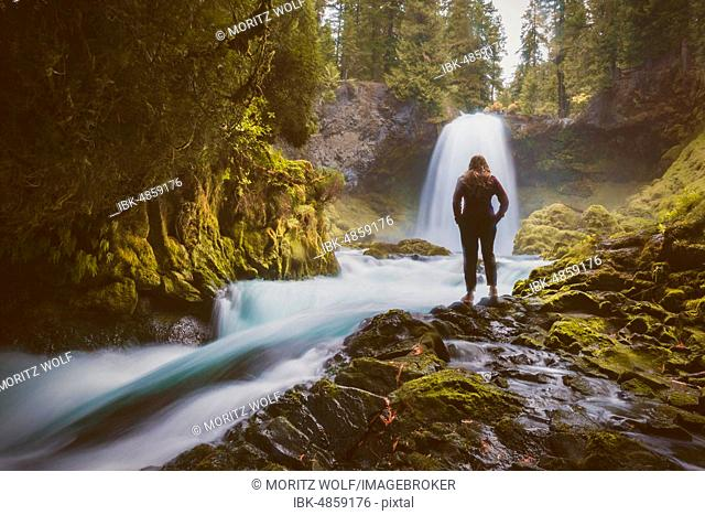 Woman in front of a waterfall, Sahalie Falls, Oregon, USA