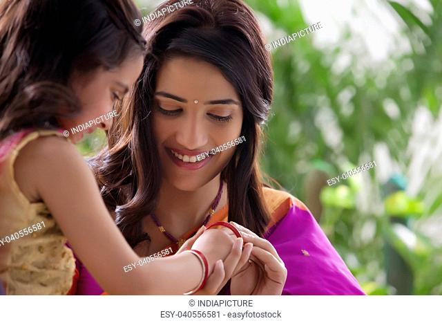 Young girl wearing bangles
