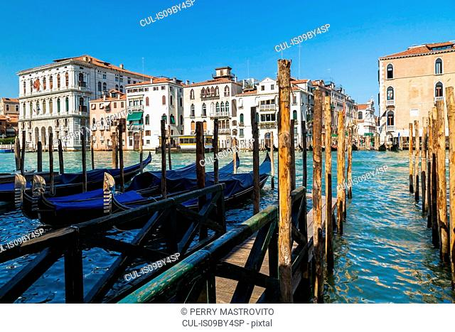 Mooring poles and gondolas on Grand Canal, Renaissance architectural style residential palace buildings, St Mark's square, Venice, Veneto, Italy