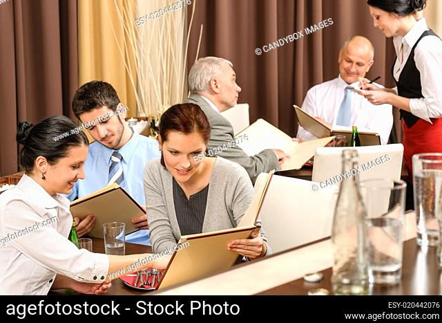 Business lunch executives looking menu restaurant