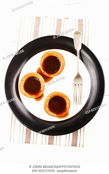 home baked yorkshire pudding with gravy on a plate