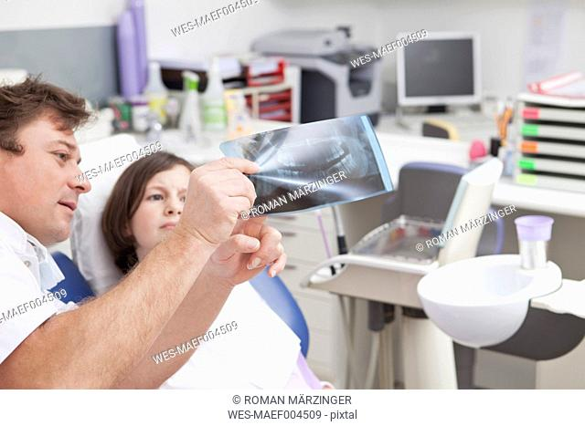 Germany, Bavaria, Patient and doctor looking at x-ray