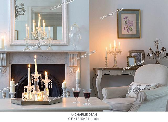 Candlelit luxury home showcase interior living room with fireplace