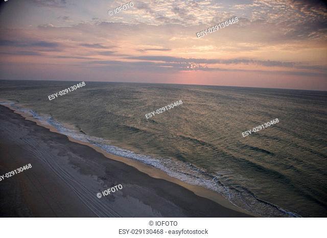 Scenic Bald Head Island North Carolina landscape of shoreline during sunrise