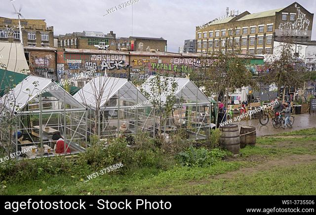 Christmas market by a canal, with visitors wearing masks and keeping social distance due to Covid-19/Coronavirus pandemia restrictions in London, England, UK