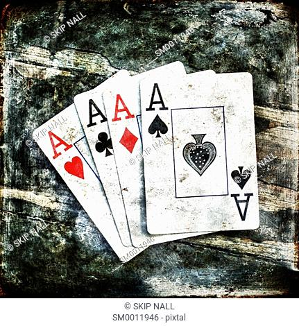 Four aces from a deck of playing cards