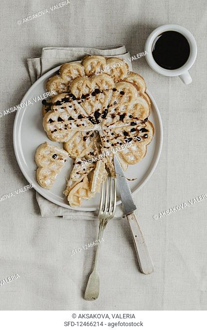 Belgian waffles with chocolate sauce for serving with coffee (top view)