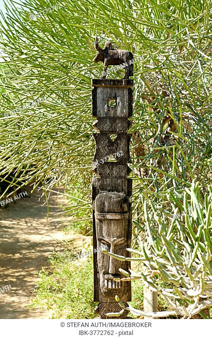 Totem carved from wood, arboretum of Tulear or Toliara, Madagascar