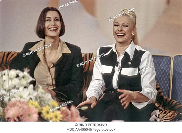 Raffaella Carrà and Claudia Koll laughing in 40 minuti con Raffaella. Italian TV host, actress, singer and showgirl Raffaella Carrà (Raffaella Maria Roberta...