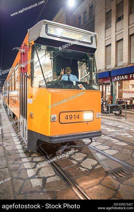 MILAN, ITALY - SEPTEMBER 2015: City tram speeds up along city streets at night
