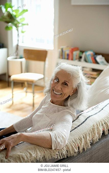 Portrait of smiling older woman on sofa