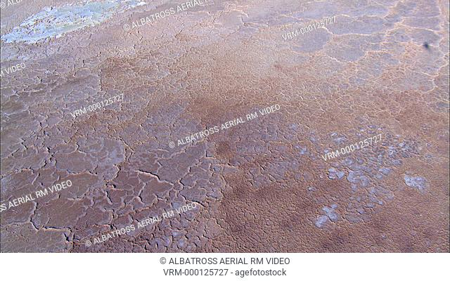 Aerial Footage of cracked earth in the Negev desert, looks like close-ups of human skin