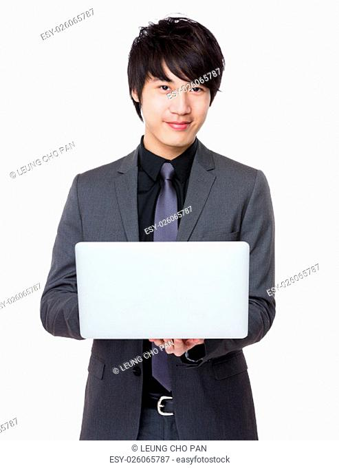 Asian Young businessman use of the laptop computer