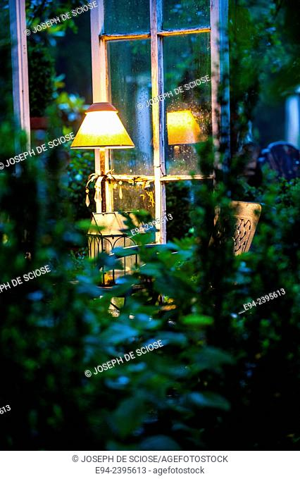 A table and lamp in an outdoor living space in a garden.Georgia USA